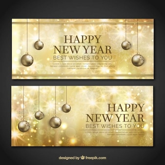 Golden new year banners with balls hanging