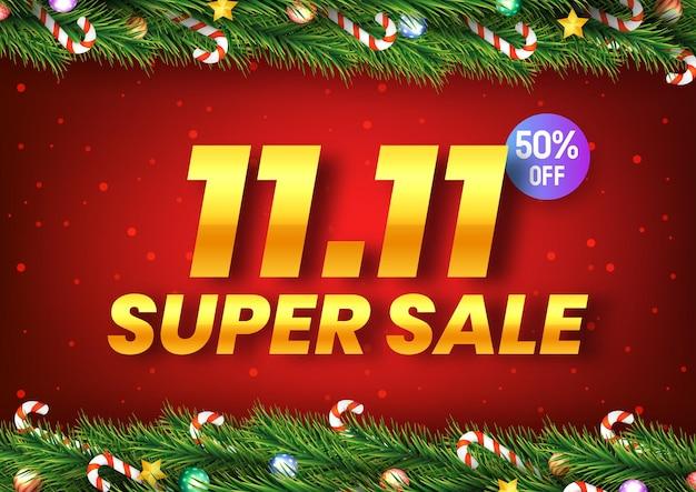 황금 11월 11일 빨간색 배경에 크리스마스 나무 가지가 있는 슈퍼 세일 쇼핑의 날