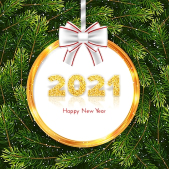 Golden numbers 2021 on fir tree branches wreath background. holiday gift card happy new year