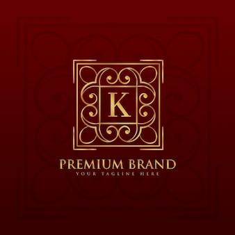Golden ornamental logo with the letter k