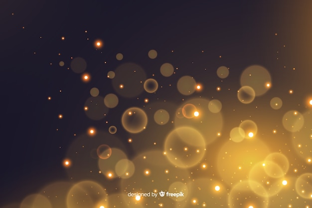 Golden particles bokeh decorative background