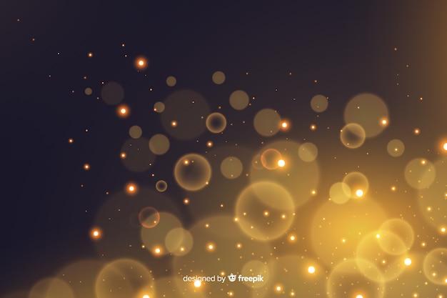 Golden particles bokeh decorative background