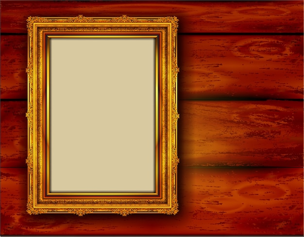Golden photo frame on wood wall
