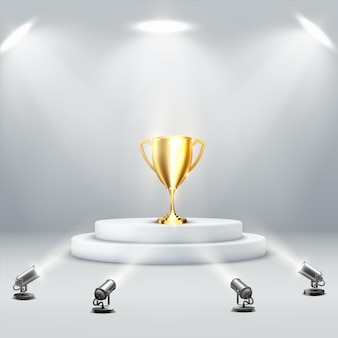 Golden podium cup on light background.  sport trophy. victory concept. winner award. vector illustration of white round podium with trophy award cup illuminated by floor spotlights.