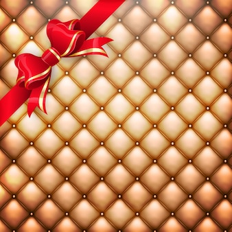 Золотой реалистичный кожаный узор обивки фон с красным подарочным бантом.
