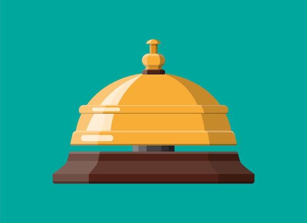 Золотой служебный колокол. концепция помощи, сигнализации и поддержки. гостиница, больница, рецепция, лобби и консьерж.