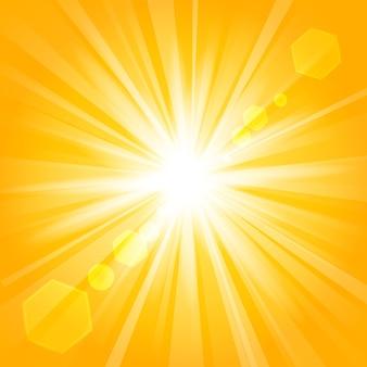レンズのフレアの背景と黄金の輝き