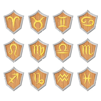 The golden signs of the zodiac are arranged on wooden boards with metal facets