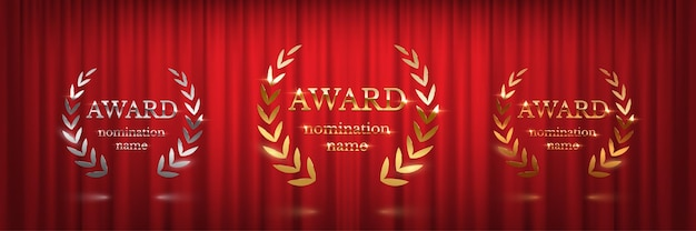 Golden silver and bronze award signs with laurel wreath isolated on red curtain background