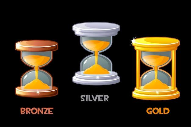ゲームの時間を測定するためのゴールデン、シルバー、ブロンズの砂時計。ベクトルイラストは、グラフィックデザインの金属光沢時計を設定します。