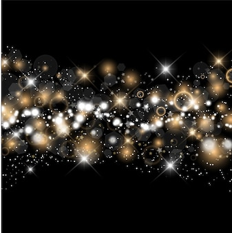 Scintillii oro e d'argento su sfondo nero