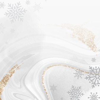 Golden snowflake over marble background