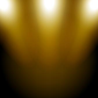 暗い背景に輝くゴールデン・スポットライト
