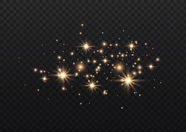 金色の星が特別な光で輝きます輝く魔法の塵の粒子