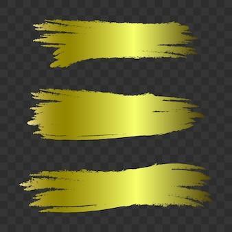 Golden textured brush strokes, vector set