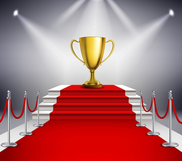 Golden trophy on white stairs covered with red carpet and illuminated by spotlight