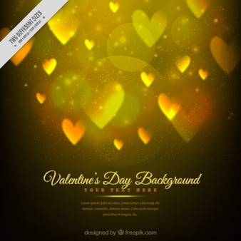 Golden valentine's day background with hearts and bokeh effect
