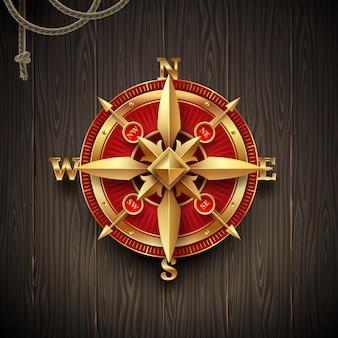 Golden vintage compass rose on a wooden plank background.   illustration.