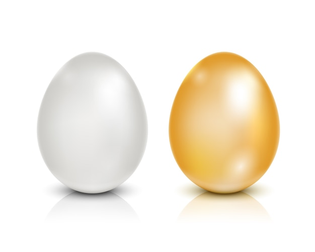 Golden and white eggs isolated