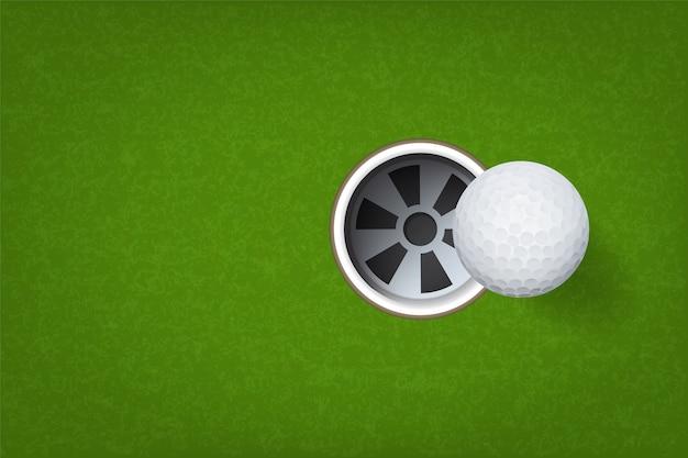 Мяч для гольфа и отверстие для гольфа.