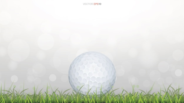 Golf ball on green grass field with light blurred bokeh background