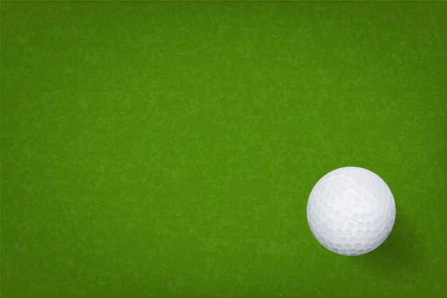 Golf ball on green grass texture background.