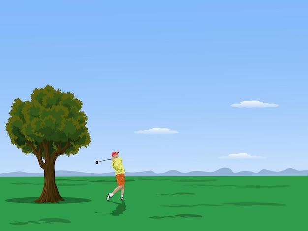 山と空を背景にゴルフコースでゴルフをするゴルファー。