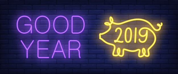 Good year neon text with pig