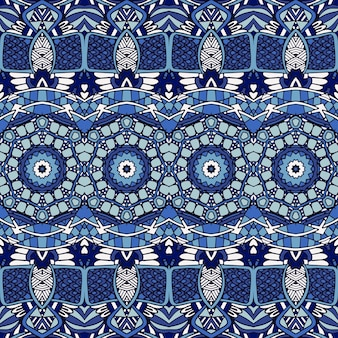 Gorgeous seamless patchwork pattern from blue oriental tiles, ornaments.
