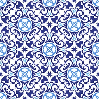 Gorgeous seamless patchwork pattern from blue and white oriental tiles, ornaments.
