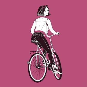 ジーンズ、トレーナー、ベストライディングバイクを身に着けているゴージャスな若い女性。