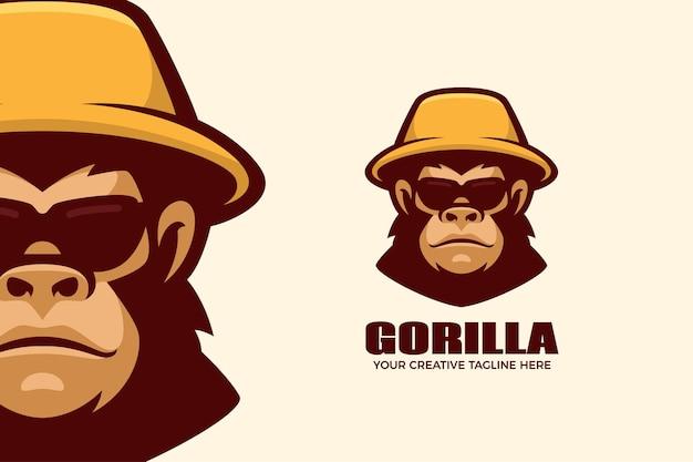 Шаблон логотипа мультяшного талисмана гориллы в шляпе