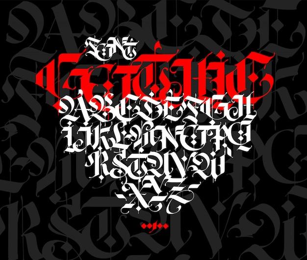 ゴシック様式のアルファベット。黒の背景に文字と記号。白いマーカーで書道。
