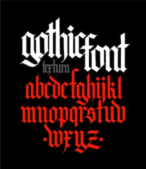 Gothic style alphabet letters and symbols on a black background calligraphy with a white marker