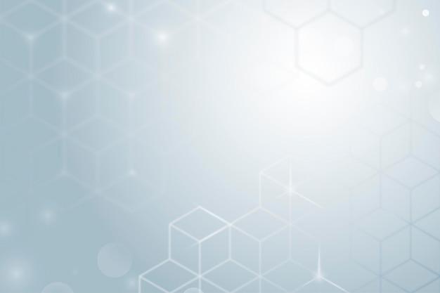 立方体のパターンと灰色のグラデーションの背景ベクトル
