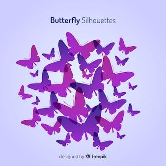 グラデーション蝶シルエットを背景に飛んで