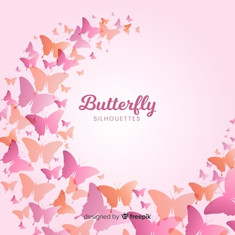 Gradient butterfly silhouettes flying