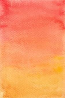 グラデーションの赤と黄色の水彩画の背景