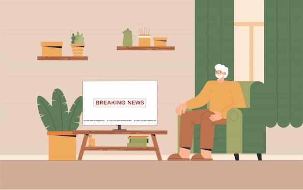 Granddfather сидя на софе смотря новости тв дома в уютной комнате.