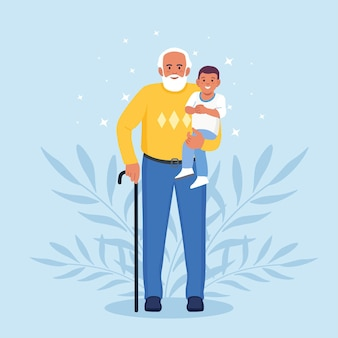 Grandfather holds grandson in his arms. grandpa with love hugging kid boy. generations and family relationship