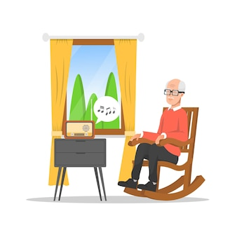 Grandfather is sitting in a rocking chair while listening to the radio