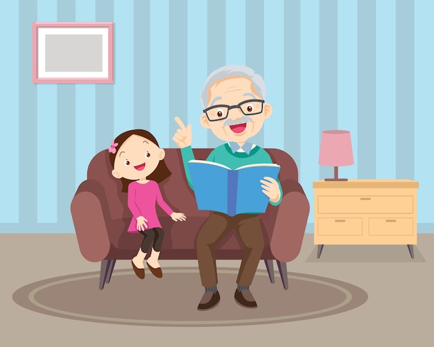 本が付いているソファーに孫と座っている祖父