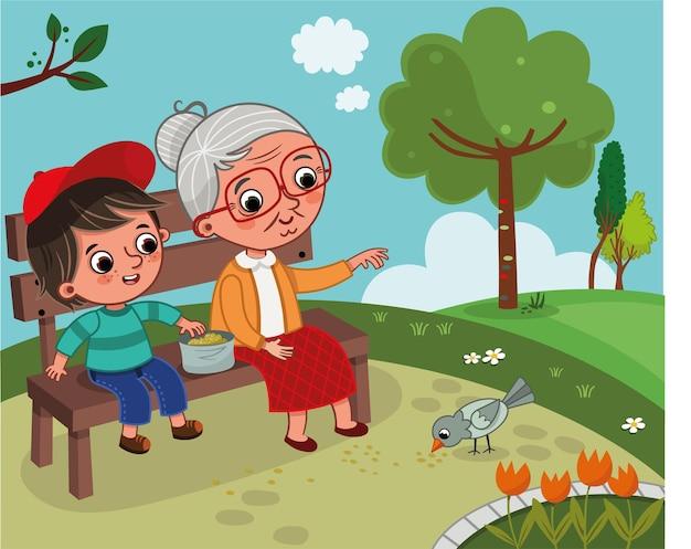祖母と孫は自然の中にいます彼らは公園のベンチに座っています