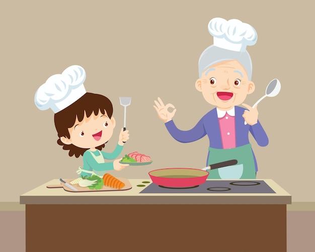 祖母と小さな孫娘が一緒に食べ物を作る