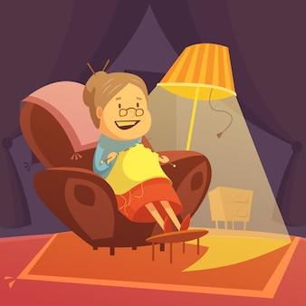 祖母は肘掛け椅子に編み物