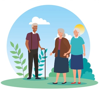 Grandmothers and grandfather avatars at park vector design