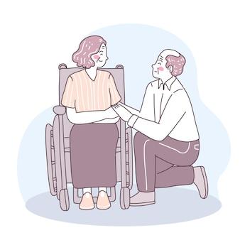 할아버지는 무릎을 꿇고 휠체어를 탄 할머니를 사랑한다고 말씀하셨습니다.