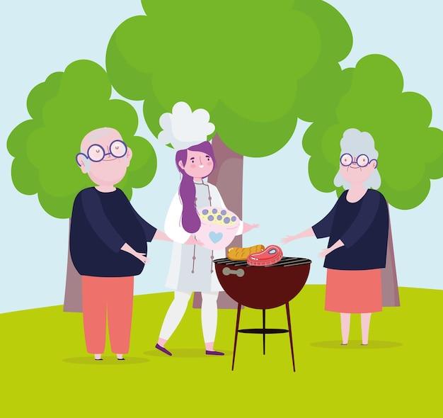 祖父母と女性シェフが屋外でピクニックを準備しています
