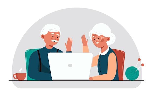 Бабушка и дедушка болтают по скайпу пожилая пара наслаждается друг другом