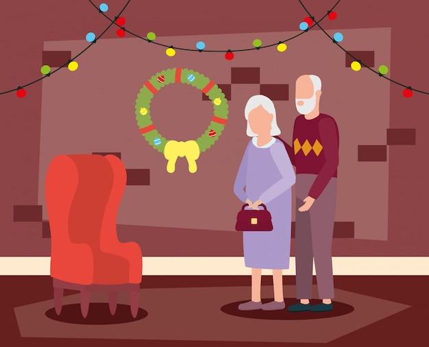 Пара бабушек и дедушек в гостиной с рождественские украшения